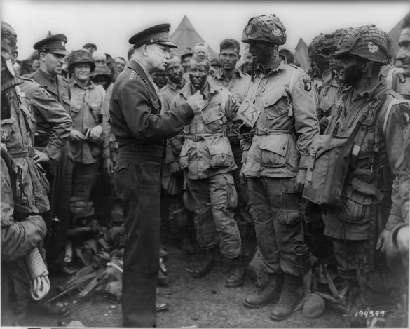 "Supreme Allied Commander Gen. Dwight D. Eisenhower gives the order of the Day. ""Full victory-nothing less"" of the 101st Airborne Division in England, just before they board their airplanes to participate in the first assault in the D-Day invasion of Normandy."